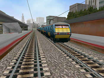 GNER 91006/07 hurdling at speed through a modern city.
